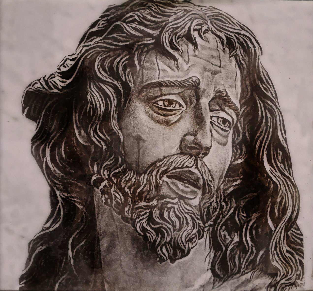 CHRIST FACE ON WHITE MARBLE
